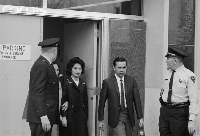 April 1967, Peoria, Illinois, USA --- The Lone Survivor.  Peoria, Illinois:  Corazon Amurao leaves the court here with her mother (partially hidden, second from left) after her cross examination in the trial of Richard Speck in April, 1967.  Miss Amurao, 24, is the sole survivor in the brutal Chicago massacre of eight student nurses.  Currently, the attractive Filipino has resumed her nursing activities in Manila and is running for councilor in her home town of San Luis, Batangas, south of Manila, in the upcoming November elections.  Other is picture are unidentified. --- Image by © Bettmann/CORBIS