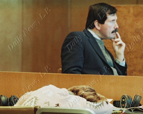 "Police Detective John Bonaiuto testifies in the 'Fatal Attraction"" trial of Carolyn Warmus as Warmus rest her head on table."